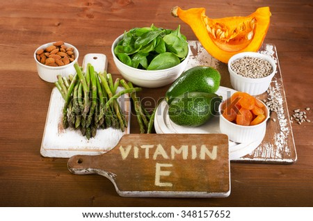 Foods containing vitamin E on a wooden board. View from above - stock photo