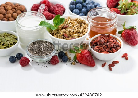 foods for healthy nutrition and fresh berries on white table, closeup - stock photo