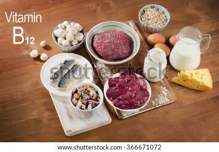 Foods Highest in Vitamin B12 (Cobalamin) on a wooden background. Healthy diet. - stock photo