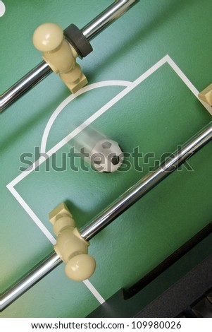 Foosball going into the opponent's goal - stock photo