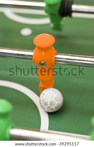 Foosball player with ball - stock photo