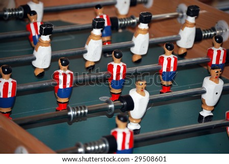 Foosball. Table football. Entertainment playing a miniature soccer - stock photo