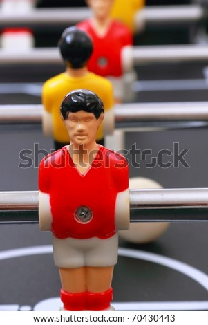 foosball table soccer little men playing game