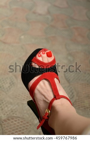 foot in sandal  - stock photo
