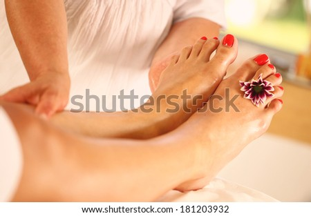 Foot massage in the Spa - stock photo