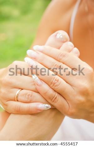 Foot massage (shallow DoF) - stock photo