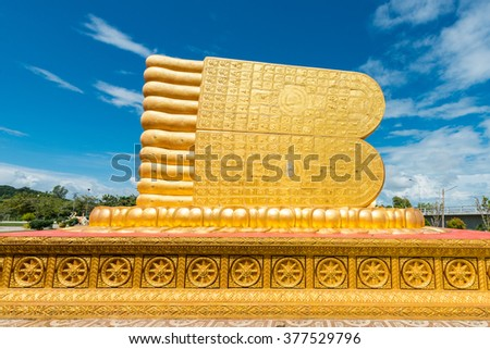 Foot of Reclining buddha at Songkhla ,Thailand.Generality in Thailand,This photo is public domain or treasure of Buddhism,no restrict in copy or use.No any trademark or restrict matter in this photo - stock photo