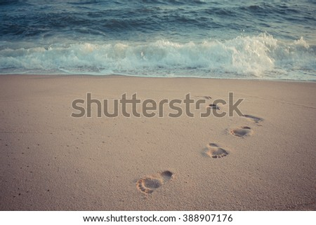 foot print in the sand at the beach background - stock photo