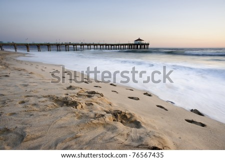 Foot Prints in the Sand at the Manhattan Beach Pier - stock photo