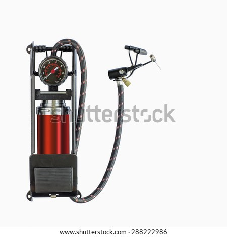 Foot pump with air pressure gauge isolated on a white background - stock photo