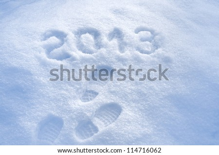 Foot step print in snow, New Year 2013 concept - stock photo