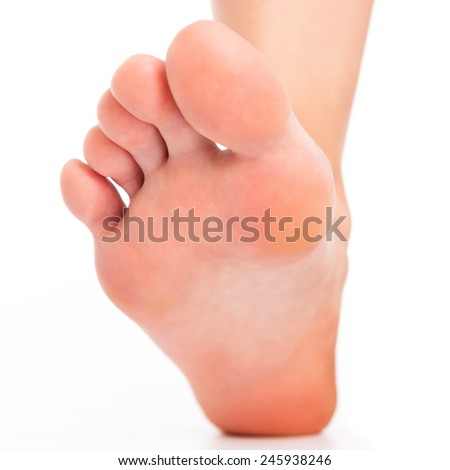 Foot stepping on white - stock photo