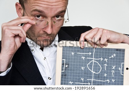 footbal coach with slate board - stock photo