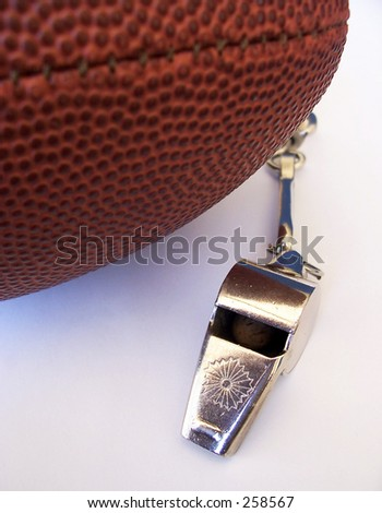 Football and Coaches Whistle - stock photo