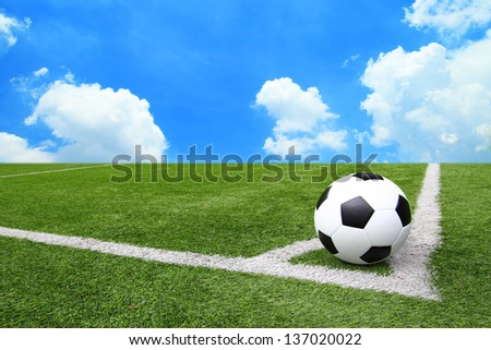 Football and soccer field grass stadium Blue sky background - stock photo