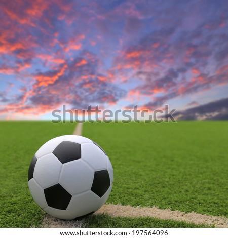Football and soccer field grass stadium sunset sky background  - stock photo