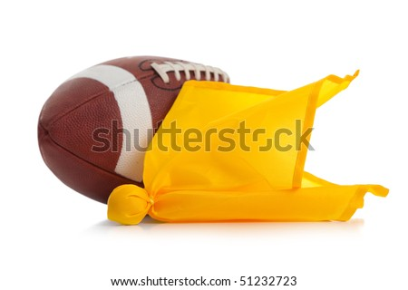 Football and yellow penalty flag on a white background - stock photo