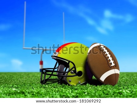 Football Ball and Helmet On Grass
