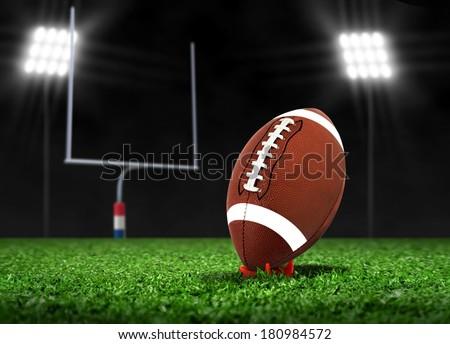 Football Ball On Grass under Spotlights - stock photo