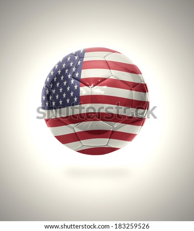 Football ball with the national flag of America on a gray background - stock photo