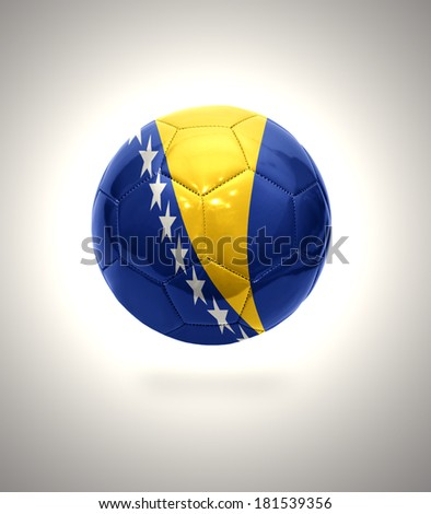 Football ball with the national flag of Bosnia and Herzegovina on a gray background - stock photo