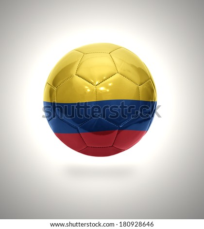 Football ball with the national flag of Colombia on a gray background - stock photo