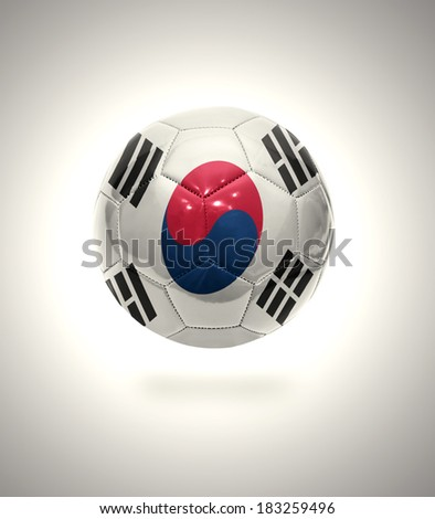 Football ball with the national flag of South Korea on a gray background - stock photo