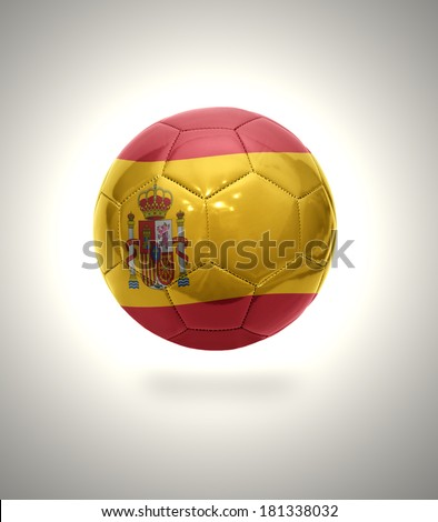Football ball with the national flag of Spain on a gray background - stock photo