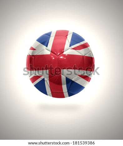 Football ball with the national flag of United Kingdom on a gray background - stock photo
