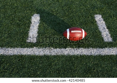 Football between the hashmarks - stock photo