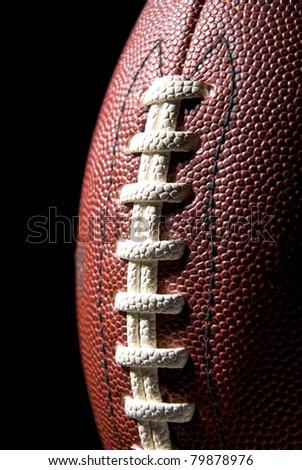 Football, black background - stock photo