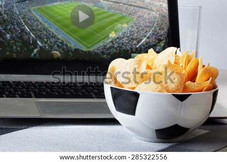 football bowl of chips at a computer with a video broadcast sports fan men, sports, view, home, food - stock photo