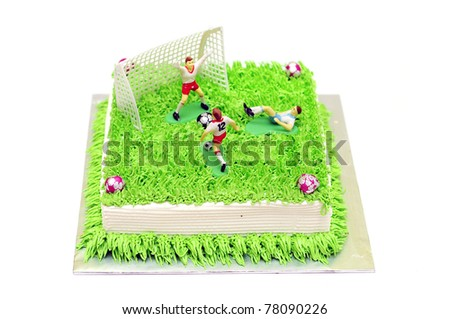 Football cake with player miniature isolated white background - stock photo