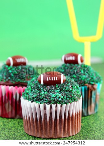 Football cupcakes for the big Sunday game - stock photo