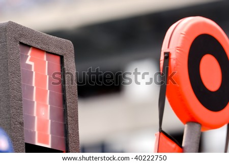 Football down markers on the sideline of a game - stock photo