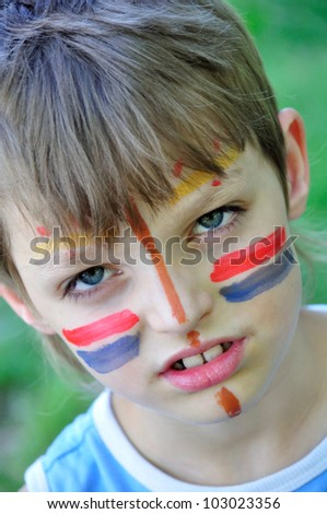 football fan child with painting on his face - stock photo