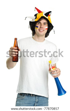 Football fan with beer and trumpet - stock photo