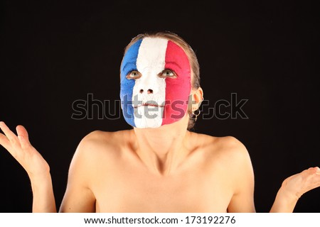Football fan with face painted in France color on black background