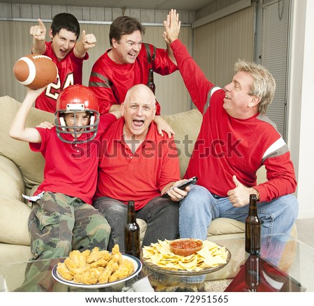 Football fans excited because their team is winning. - stock photo