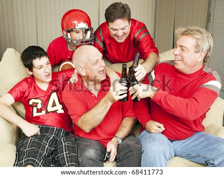 football fans toasting success with their beer bottles. - stock photo