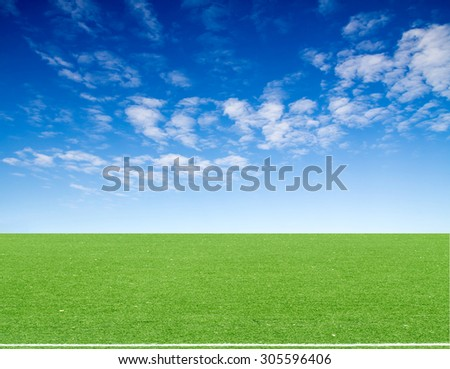 football field blue sky with clouds