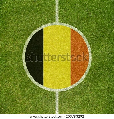 Football field center closeup with Belgian flag in circle  - stock photo