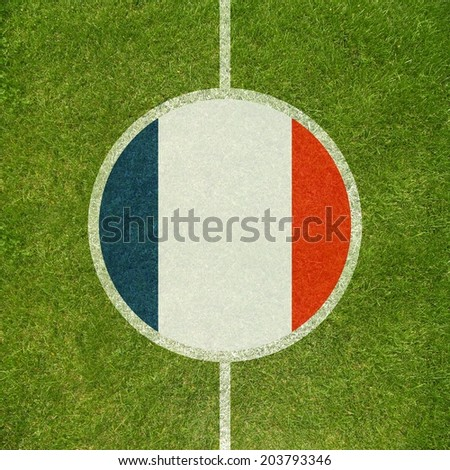 Football field center closeup with French flag in circle  - stock photo