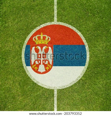 Football field center closeup with Serbian flag in circle  - stock photo