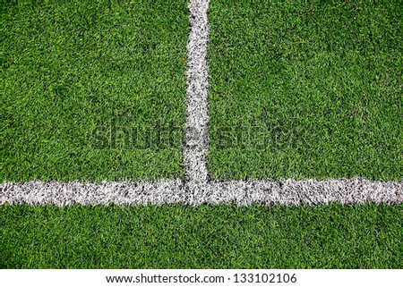 Football field detail with white lines. - stock photo