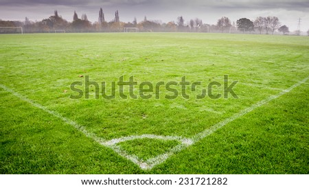 Football field, playground, in residential area, England - stock photo