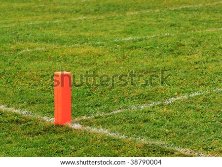 Football goal line orange marker. - stock photo