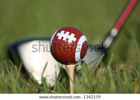 Football golf ball tee'd up - stock photo