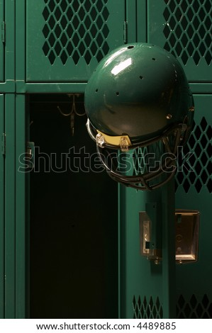 football helmets in locker room