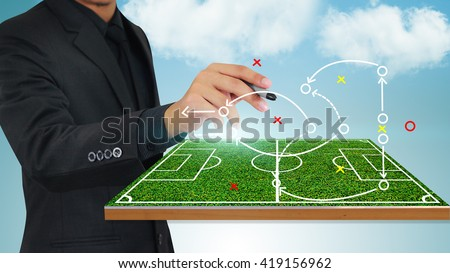 Football manager plan tactics  - stock photo